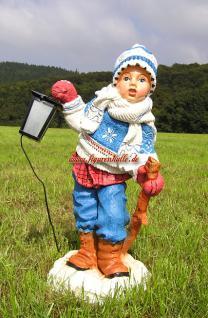 Winterdekoration Winterkind Figur mit Schla und Mütze als Deko
