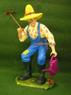Gärtner mit Latzhose als Figur oder Statue