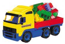 LKW mit Pritsche und Bausteinen
