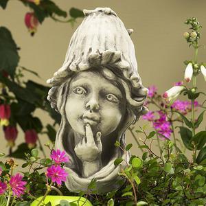 Steinfigur Blumenkind Troddelblume, Figur aus Steinguss