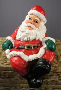 Weihnachtsmann Santa Claus Figur auf Tisch