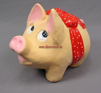 Dickes rundes Sparschwein mit lustiger Schleife