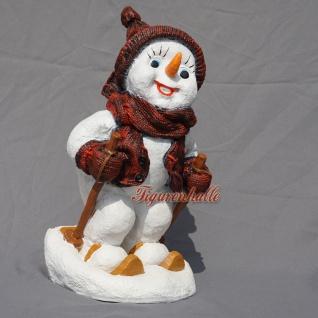 Schneemann als Figur Schneemann auf Ski Dekoration für Weihnachten