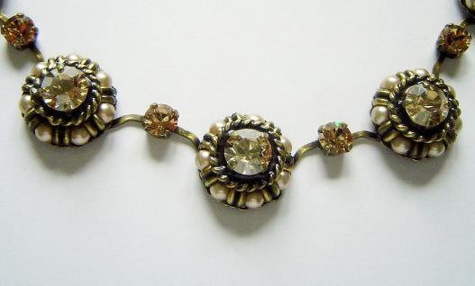 KONPLOTT Kette aus der Serie Creole beige multi / antique bronce