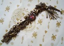 KONPLOTT Armband aus der Serie Casino Cabaret brown multi / antique bronce