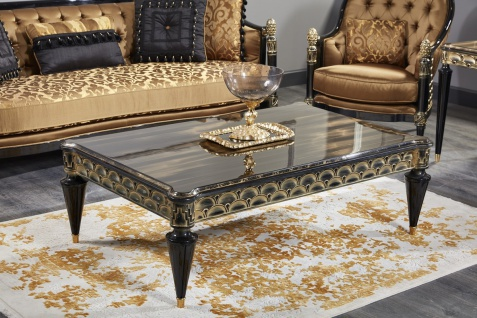 Casa Padrino Luxus Barock Couchtisch Schwarz / Gold 140 x 90 x H. 45 cm - Wohnzimmertisch im Barockstil