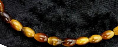 Tigerauge, Olive 6 mm, gebohrt, Strang
