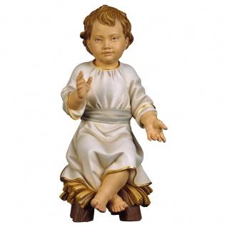 Jesuskind sitzend auf Wiege Holzfigur geschnitzt Heiligenfigur Südtirol