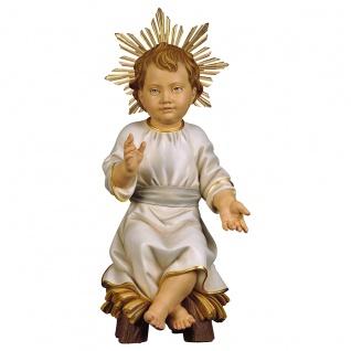 Jesuskind sitzend auf Wiege mit Heiligenschein Holzfigur geschnitzt