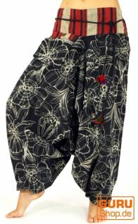 Weite Haremshose mit breitem Webbund und Blumendruck - schwarz