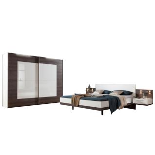 Nolte Möbel Novara Schlafzimmer bestehend aus Schwebetürenschrank 2-türig Doppelbett mit Polster-Kopfteil Kunstleder Weiß Liegefläche ca. 180 x 200 cm 2 Paneele mit Ablageboden Aufsatz-Nachtschränken und Klarglasböden mit Beleuchtung in Eiche-Nachbildung