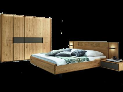 Wöstmann WSM 1600 Schlafzimmer 2-teilig in der Ausführung Europäische Wildeiche Massivholz mit Bett Liegefläche wählbar und 5-türigem Drehtürenschrank optional mit Passepartout Nachtkonsolen oder Paneelaufsatz mit Beleuchtung