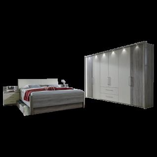 Wiemann Andorra Schlafzimmer Drehtüren-Funktionsschrank mit 2 Auszügen Bett 2 Nachtkonsolen in Trüffeleiche-Nachbildung Absetzungen Champagner-Dekor