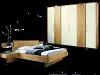 Wöstmann WSM 1400 Schlafzimmer 2-teilig Korpus- und Frontausführung Europ. Wildeiche Massivholz Bett mit Holzkopfteil Drehtürenschrank 6-türig mit 4 Mattglastüren in magnolie optional mit Hängekonsolen Wandboard und Passepartout mit Beleuchtung