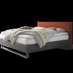 Hasena Factory-B Bett bestehend aus Bettrahmen Dallas 23-B Polsterkopfteil Milano L-B Bettkufen Indus Stoffausführung Kabo rust Holzausführung Akazie Vintage grey Liegefläche ca. 180x200 cm