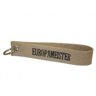Filz-Schlüsselanhänger mit Stick Europameister Gr. ca. 17x3cm 14252 beige
