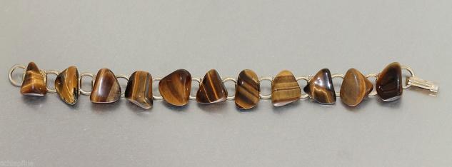 Armband, teilweise vergoldet, mit 11 Tigeraugen, Armkette