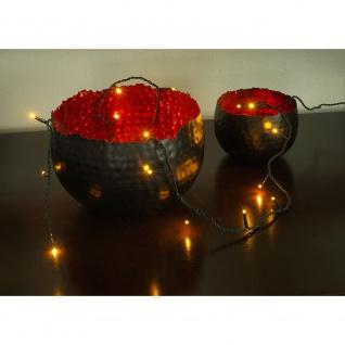 Konstsmide 6353-820 Micro LED Lichterkette verschweißt 50 bernsteinfarbene Dioden 24V Innentrafo dunkelgrünes Kabel