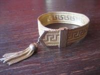 reizvolles Art Deco Armband gold Goldarmband Mäanderband Troddel verstellbar