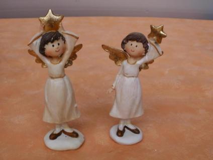 2 stehende Engel mit einem Stern im Porzellan-Look