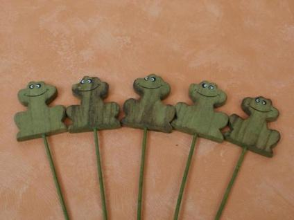 5 freundliche Frösche in Grün