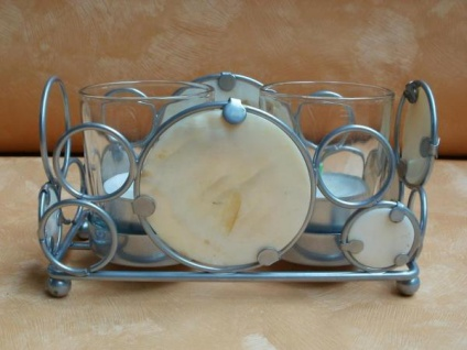 Teelichthalter aus Metall mit Muschel-Dekor
