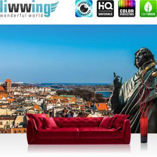 liwwing Vlies Fototapete 416x254cm PREMIUM PLUS Wand Foto Tapete Wand Bild Vliestapete - Stadt Tapete Statue Himmel blau - no. 2895