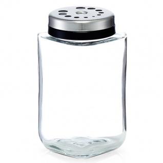 Ein Glasspender, ein Behälter für Gewürze, eine Glasschale für Salz und Pfeffer.