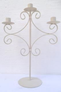 WOHNAMBIENTE Kerzenständer, Kerzenhalter Art.-Nr.: K 1049 Maße: Sockelplatte d= 12, 5 cm, Leuchterbreite 29 cm, Gesamthöhe 40 cm.